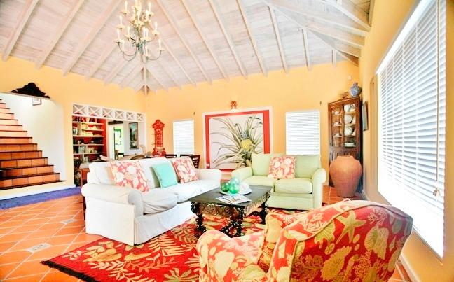 Large living room with library, bar and dining. Opens onto pool and decks.