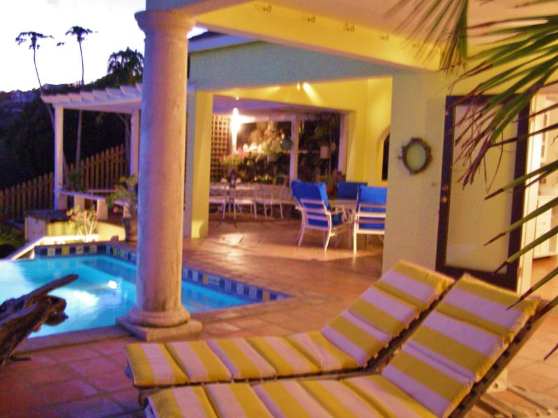 Ample deck space with many entertaining areas, leads to upper deck and gazebo with hammock.
