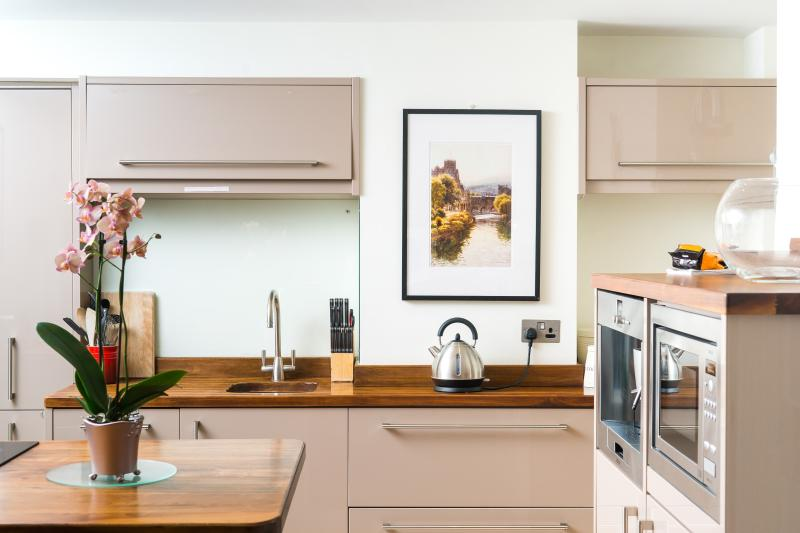 The kitchen has all modern appliances and is designed by BOSCH