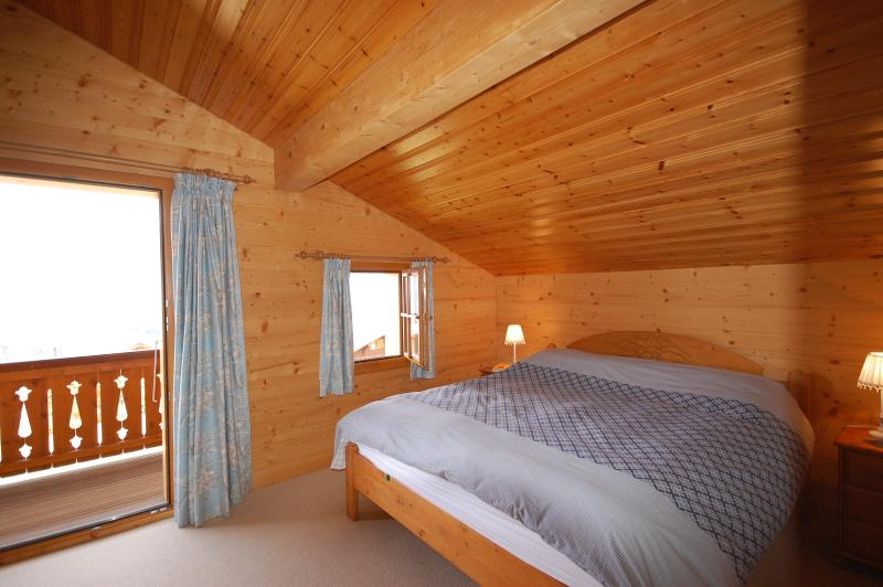 Master bedroom with double bed and balcony