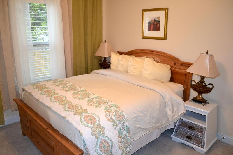 One of the 3 Queen Bedrooms. Each bedroom has an HDTV and Ceiling fan. This queen shares a bathroom.
