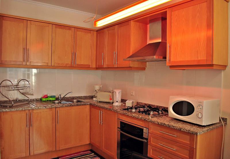 CASA DA AVENIDA. Kitchen full equipped with dish-wash, wash machine, iron, kettle...