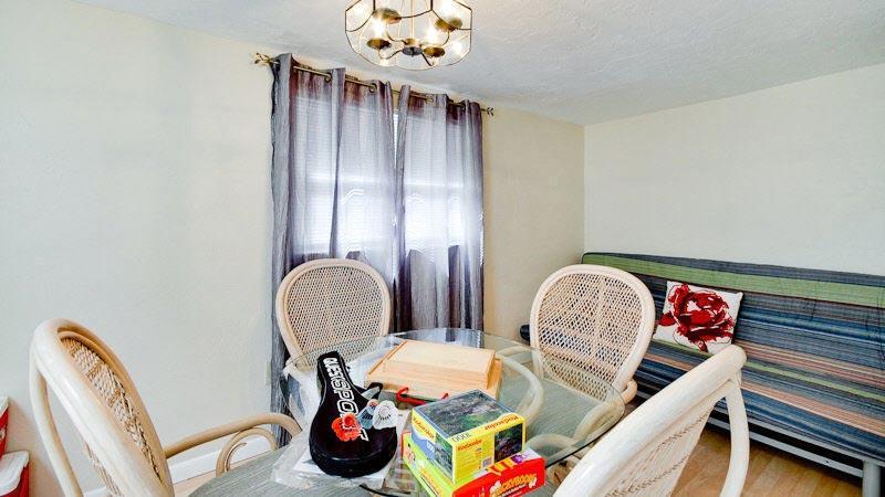 Sitting Room with Futon Behind Kitchen