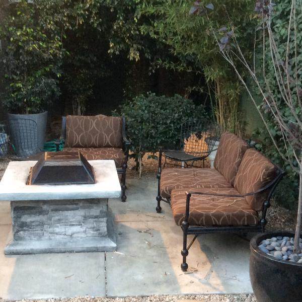 Private backyard surrounded by trees with firepit!