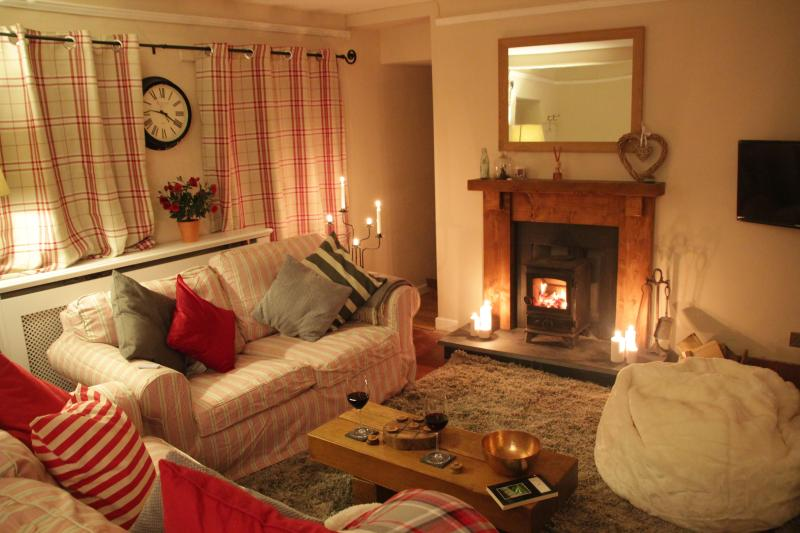 The cosy living room with woodburning stove, snuggle up and make yourself at home