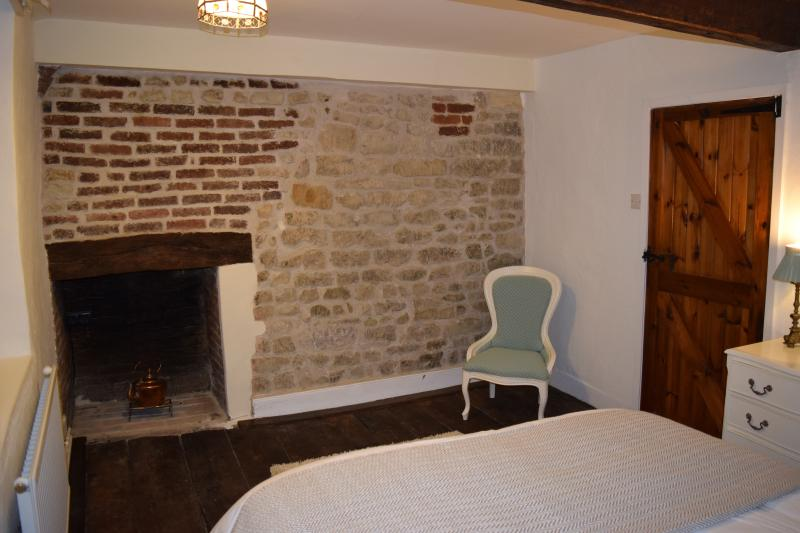 second bedroom, King size bed , early 17th C. wall in Flemish brick and stone, original oak floor.