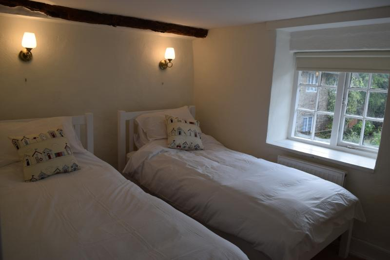Bedroom 3 with 2 single beds all beds and mattresses in all the bedrooms are brand new .