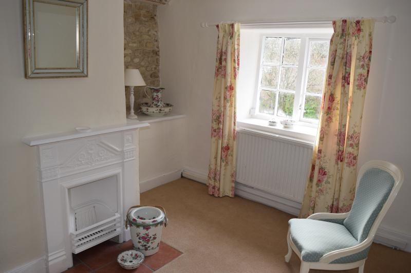 Bedroom 1 , dressing area , old 17th C. stone wall exposed