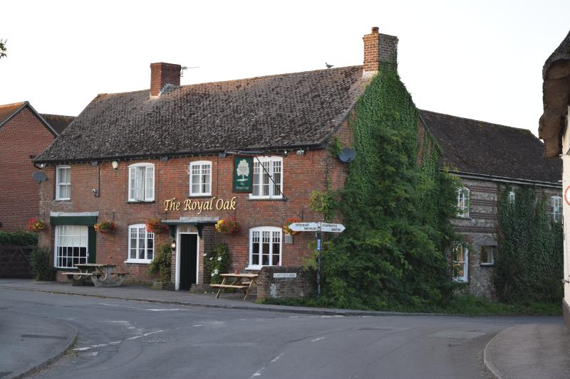 The Royal Oak, a great pub, great beer. Serves food most evenings. Local skittle clubs meet there