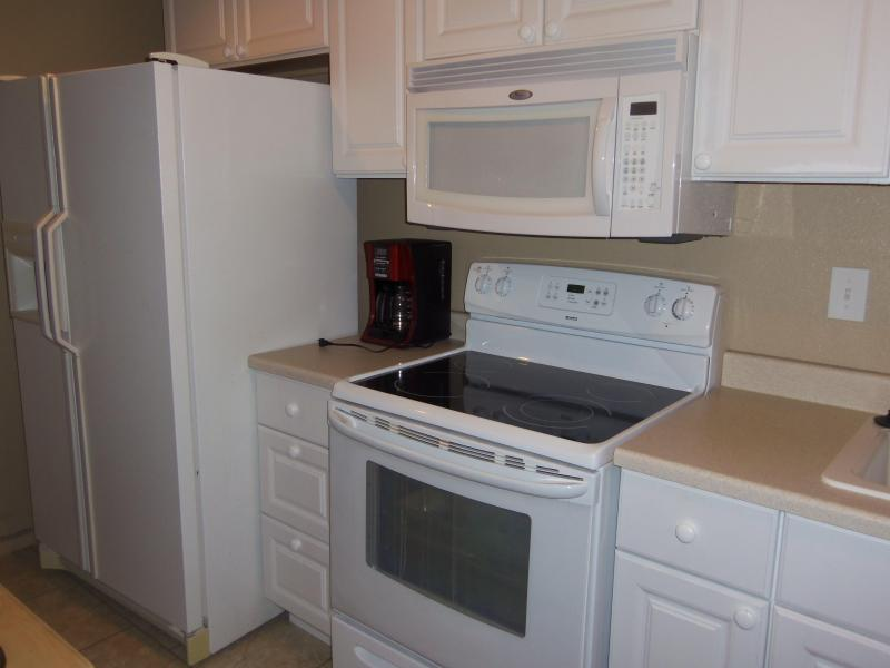 Kitchen Microwave, Side-By-Side Refrigerator, Glass Top & Oven & Kuerig Coffee Maker