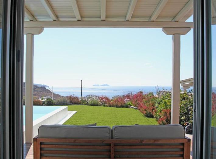 A view  to the garden, pool and sea