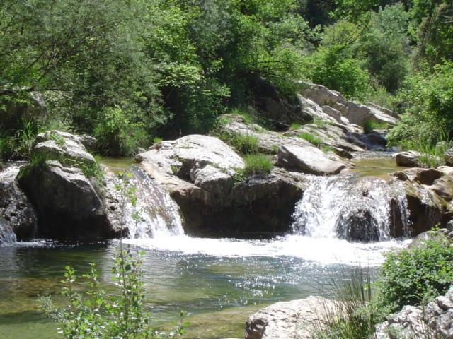 RIVER WITH ITS WATERFALL