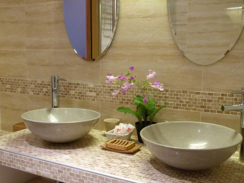 In the bathroom(shower & bath)