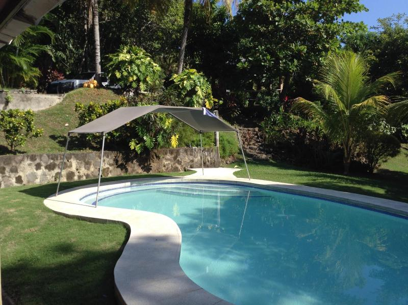 View from Kitchen overlooking private pool and garden (400 yards from private beach)
