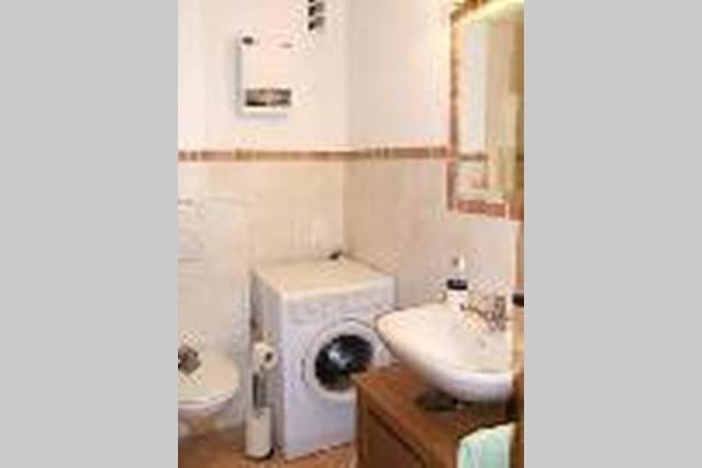 Bathroom with bath and washing machine