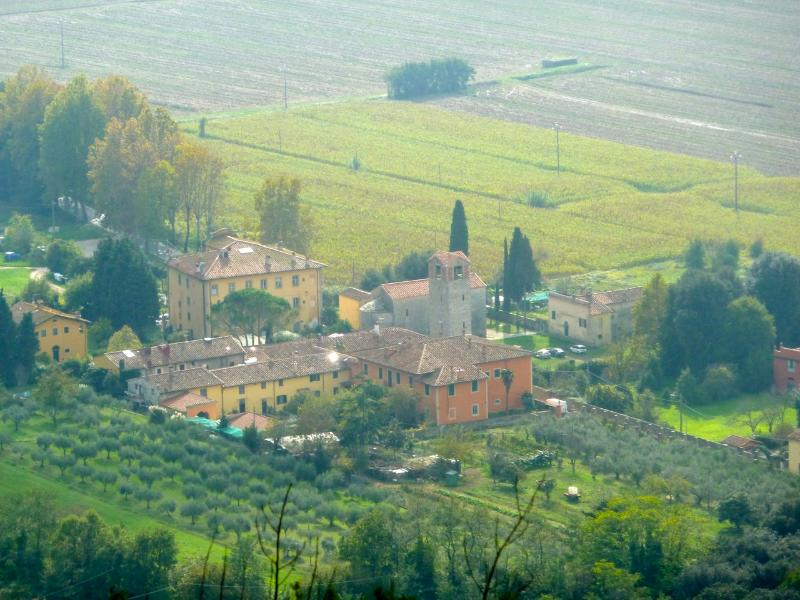 The view of the hamlet of Pugnano below the houses