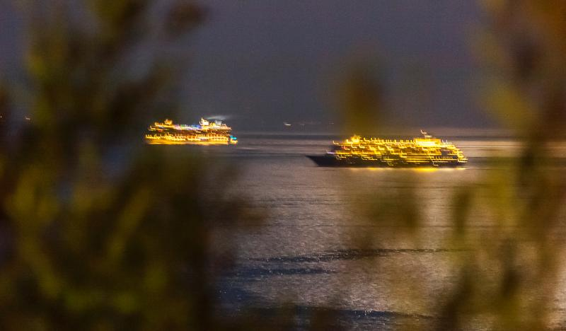Watching the cruise ships from balcony at night