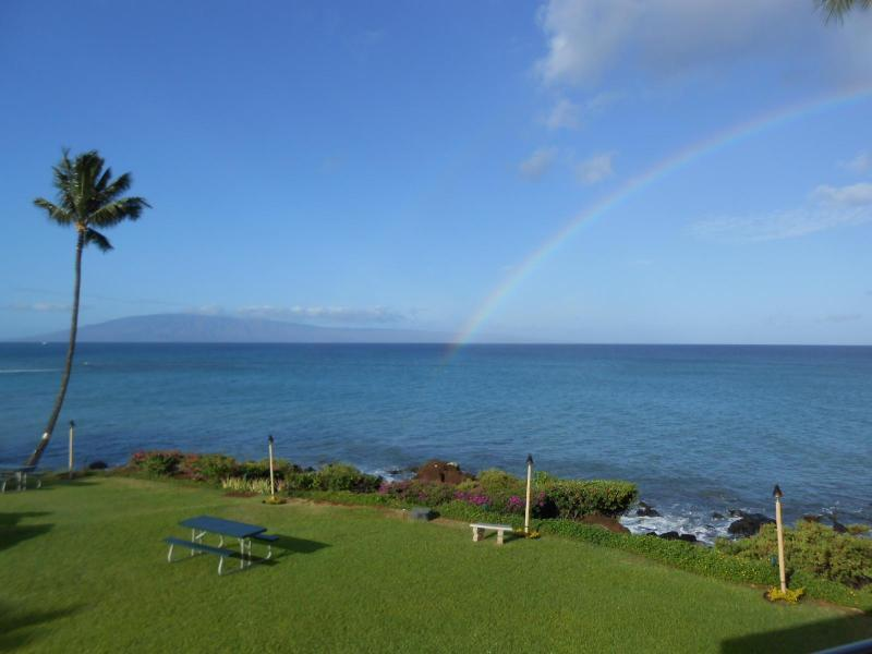 This is your view from the condo. That is the island of Lanai. The rainbow is real. Expect many!