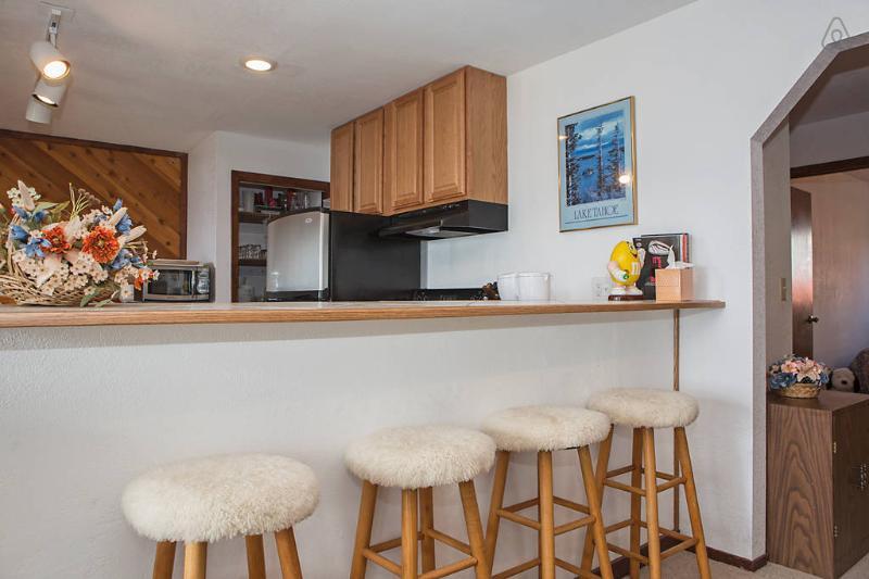 Bar stools at edge of kitchen