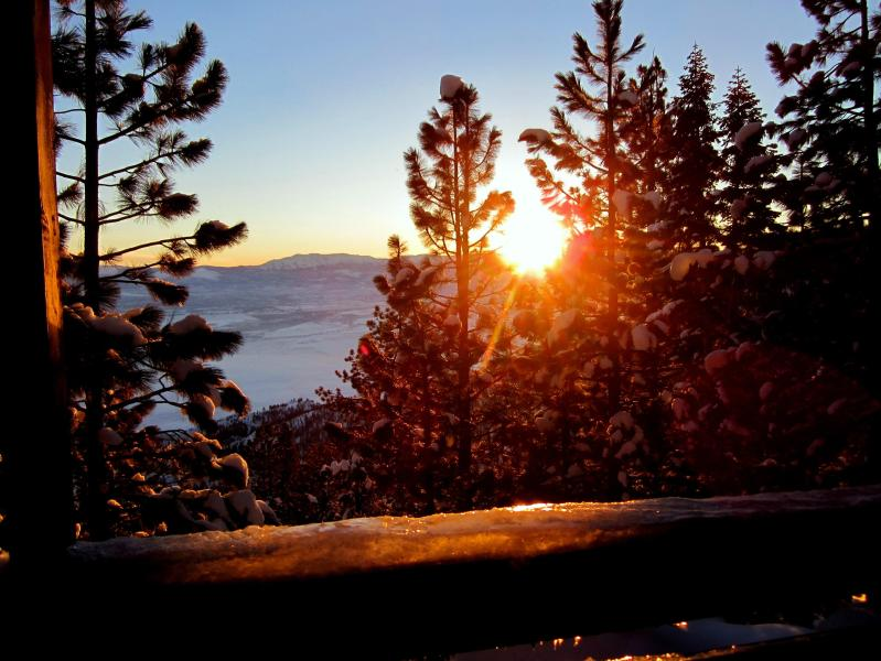 winter sunrise and snow covered valley viewed from upper rear balcony