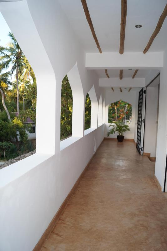 The rear balcony overlooking the pool and gardens