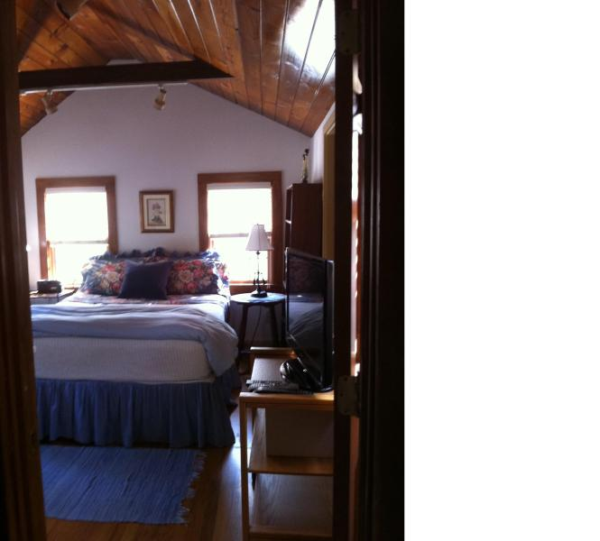 Cottage Bedroom with cathedral ceilings