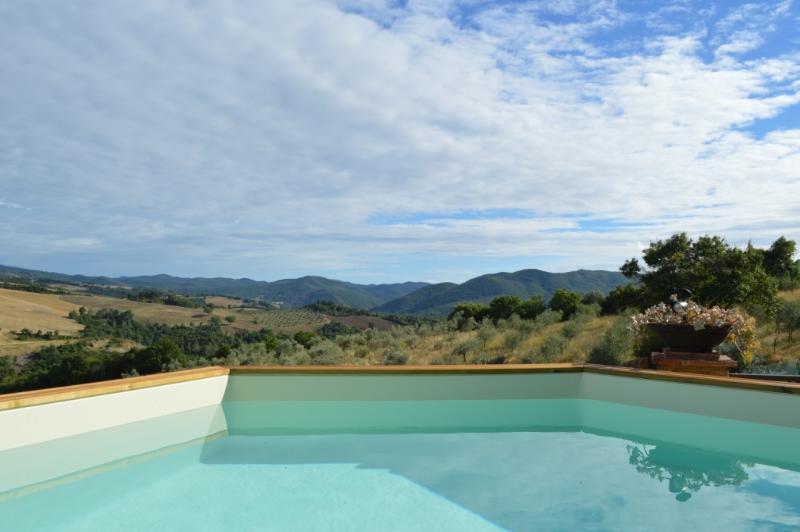 pool and views of the park Monterufoli