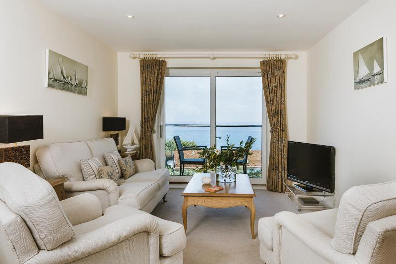 Open plan living, dining and kitchen area opening out to private balcony with amazing seaviews