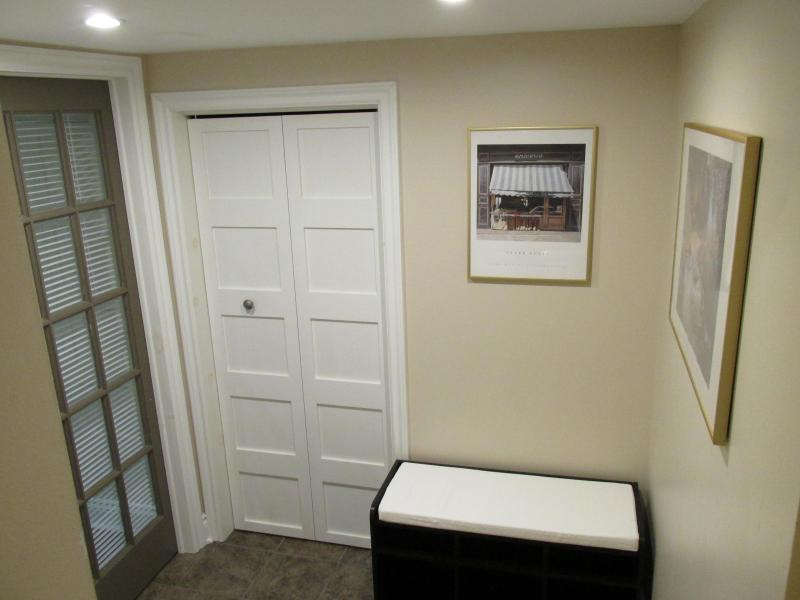 Foyer leading to apartment and laundry facilities