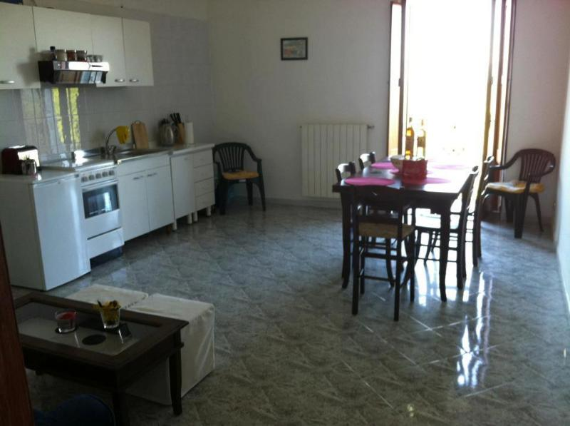 The main living area of the house, with kitchen, dining table and seating area just out of shot