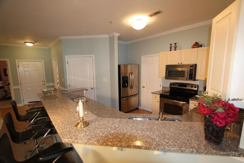 Upgraded Kitchen with Granite Counters and Stainless Steel Appliances. Pantry includes full laundry.