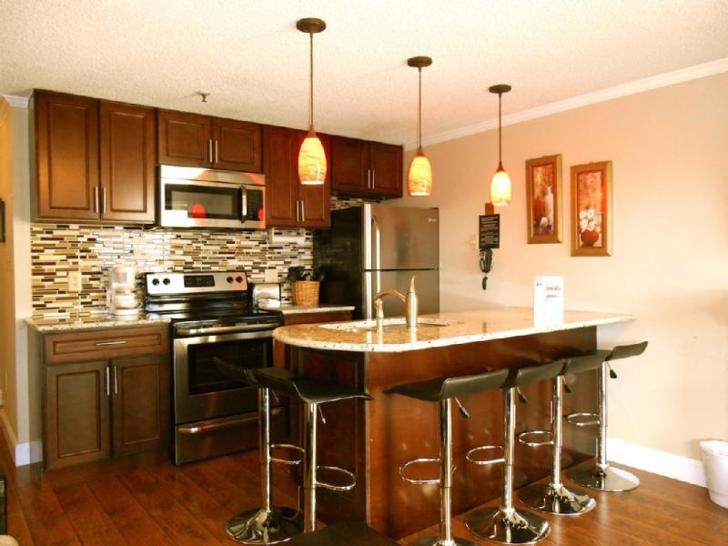 ML#207 Completely remodeled kitchen w/ granite counter, eating island, stainless steel appliances