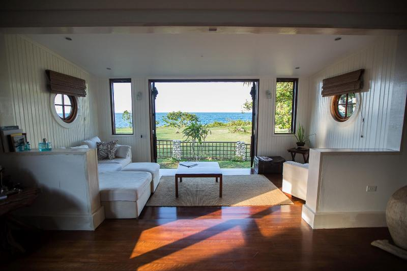 Master suite, opens right out to amazing view from the bed overlooking lawn and ocean.