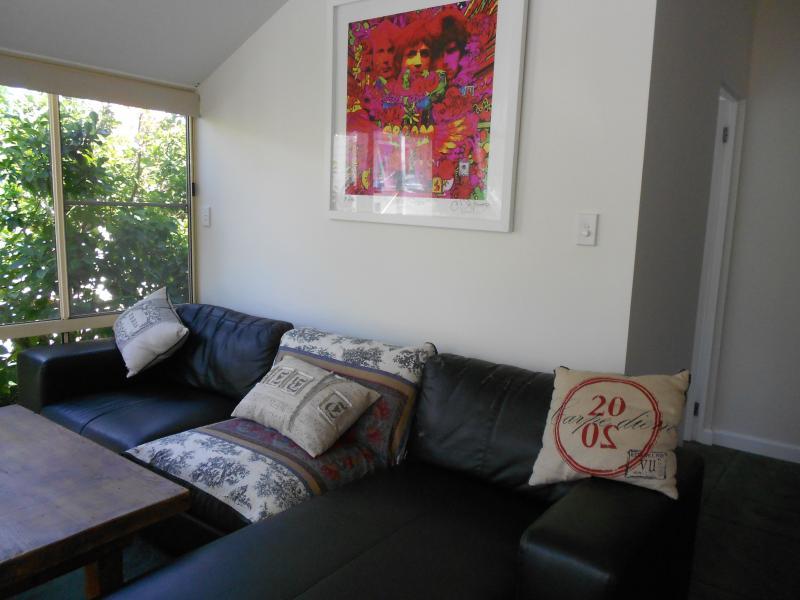 Main lounge area with relaxing garden vista