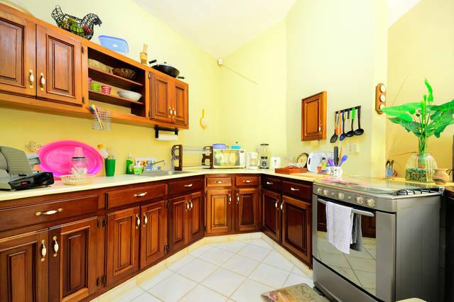 Fully equipped kitchen: cook ware, microwave, toaster, coffee maker, glasses, cutlery and dishes