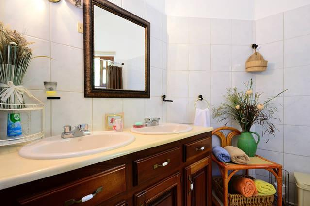 Second bathroom with double sink, cabinets from Mahogany wood, mirror, soap and towels provided