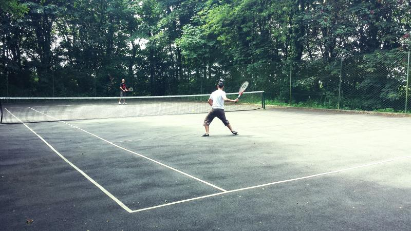 Newly resurfaced on-site tennis court