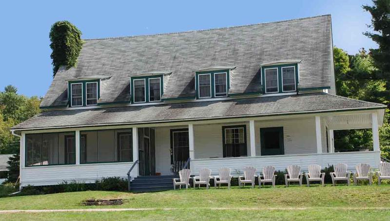 Main Lodge Cottage:  5 bedrooms; 4 bathrooms; 2600 square feet; dishwasher; fireplace; lake view.