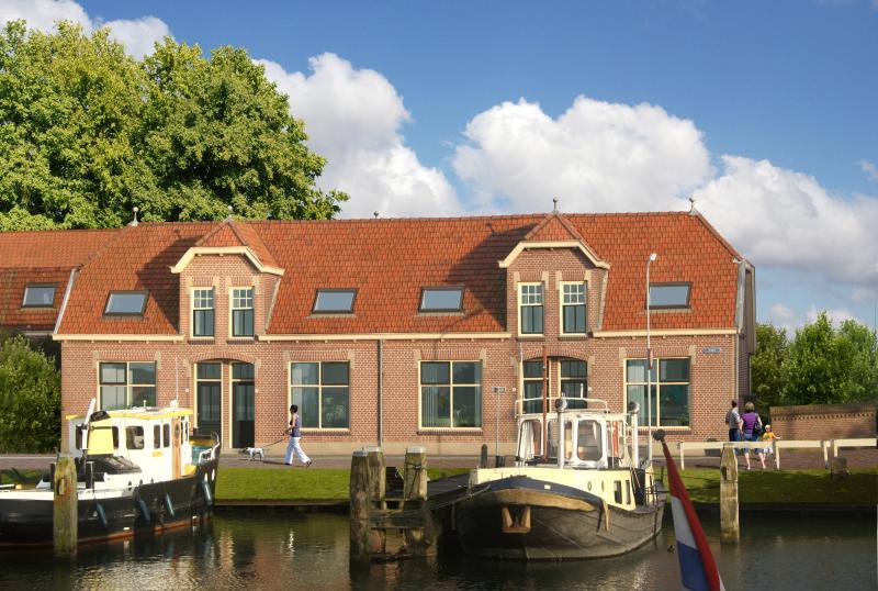 Zuiderzeehof located on port and IJsselmeer
