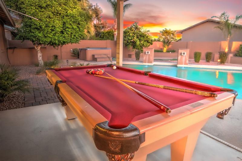 Outdoor pool table under the covered deck.