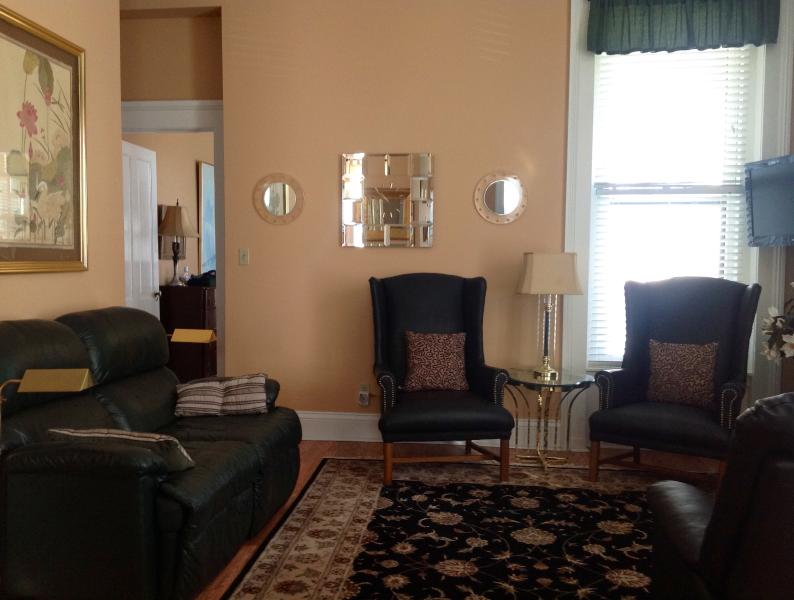 Leather reclining loveseat and 2 leather chairs