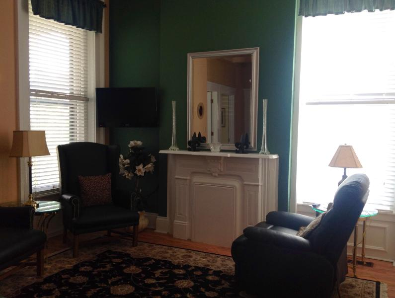 Decorative fireplace, flat screen TV and leather recliner