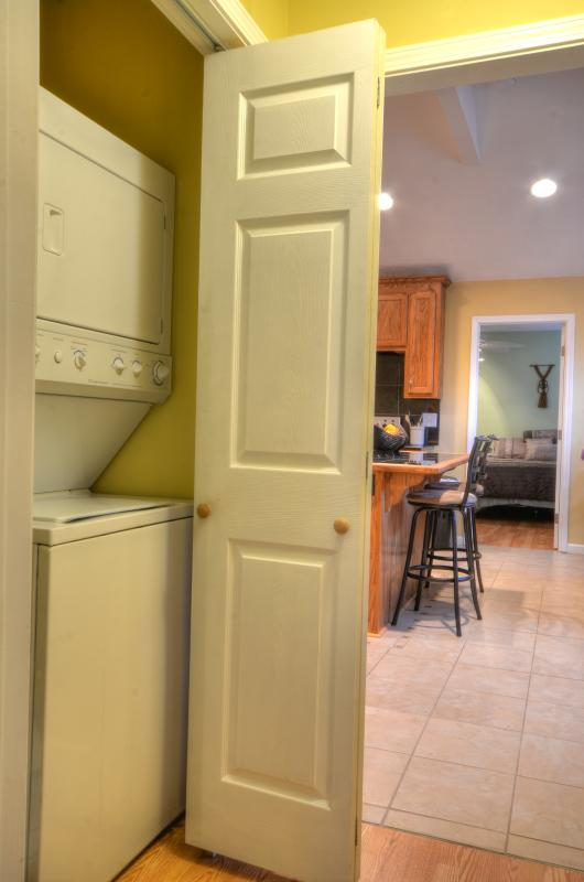 Hallway with stackable washer/dryer
