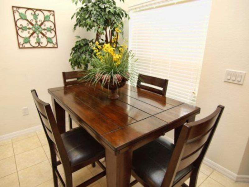 Kitchenette area with four chairs