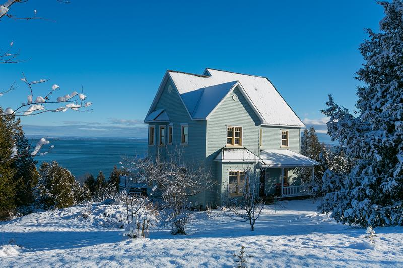 The House in winter by the St Lawrence river !