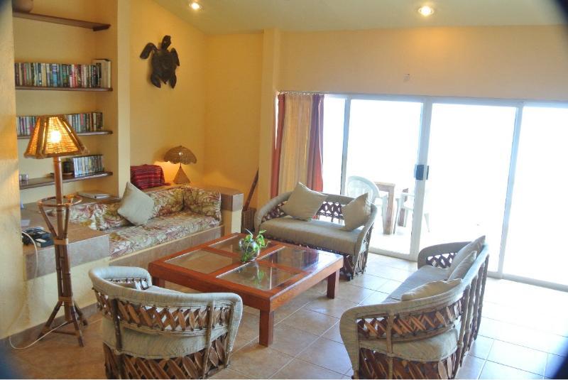 Comfortable sitting area opens onto balcony