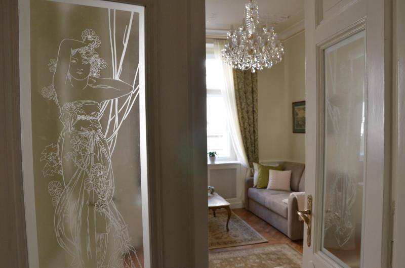 Karoline in art nouveau glass invites you in