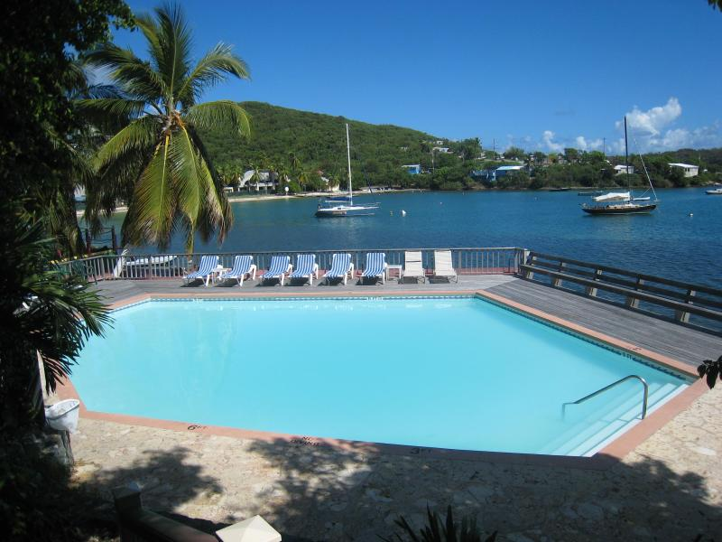 Lower waterfront pool. 1 minute from the unit