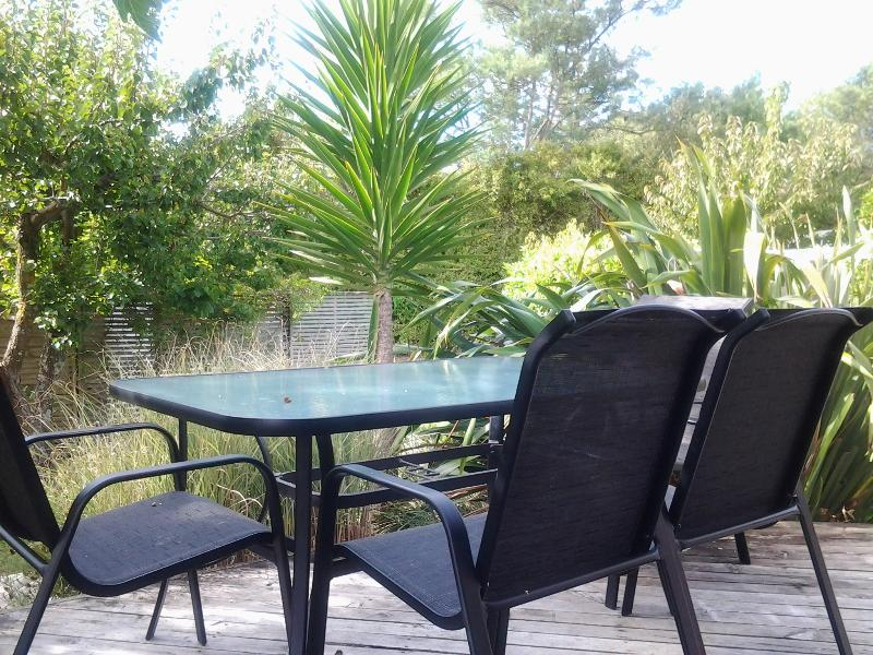 Private, sheltered outdoor dining area with BBQ