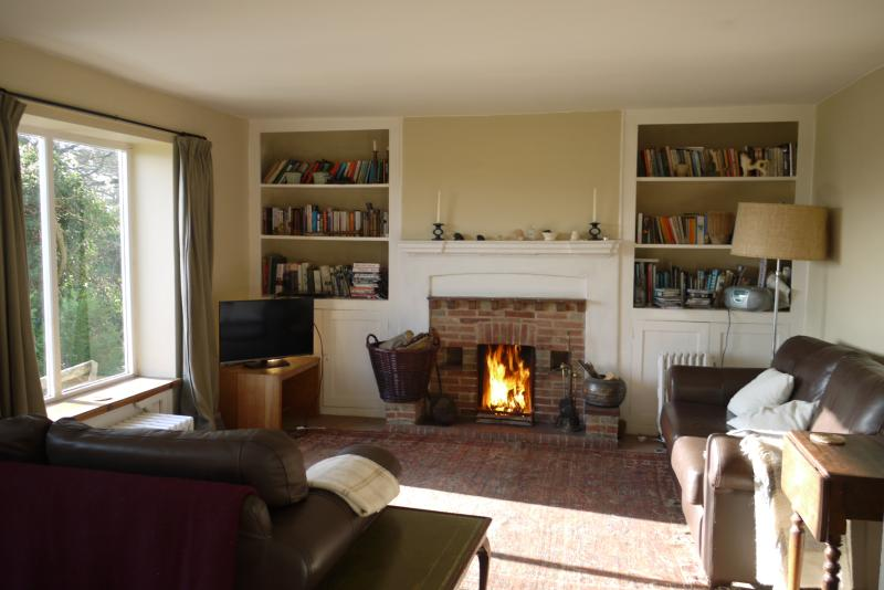 Sitting room with easy-to-use open fire. Books, games, CDs, DVDs & local info here too.